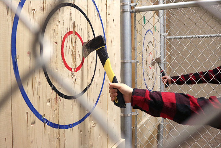 Landing a bullseye in axe throwing at the Axe Games Calgary facility